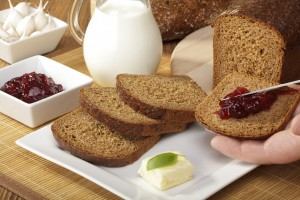 Breakfast with wholemeal bread and jam and milk