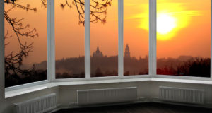 54376023 - plastic windows overlooking the beautiful fiery red sunset